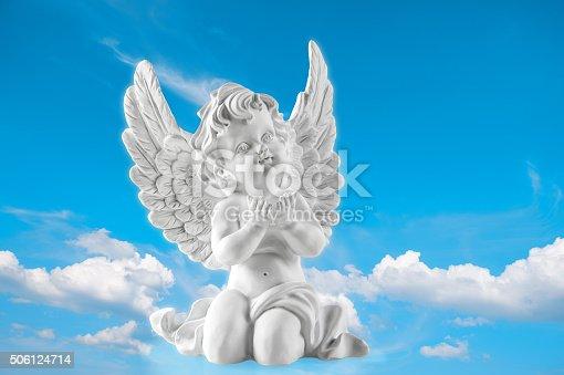 istock Guardian engel on blue sky background. Religion and faith 506124714
