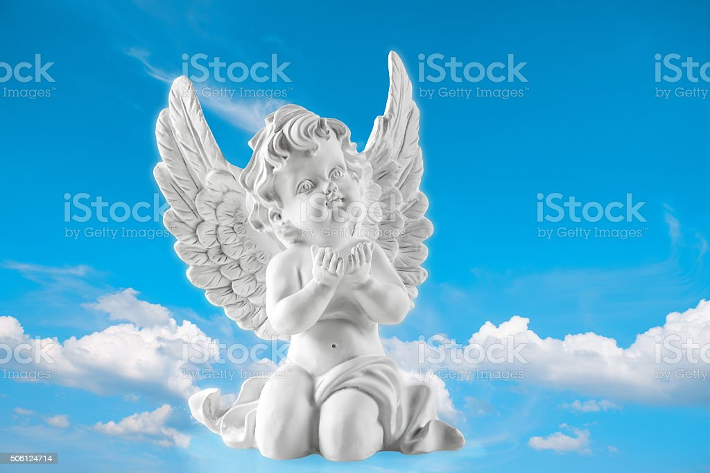 Guardian engel on blue sky background. Religion and faith stock photo