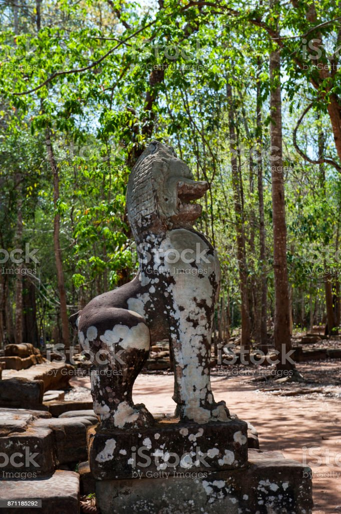 Guardian lion statue, Angkor Wat stock photo