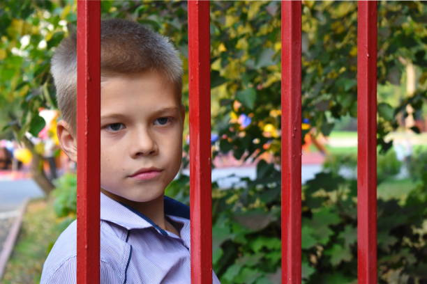guardianship authorities select children. juvenile justice. deprivation of parental rights. - boy handcuffs stock pictures, royalty-free photos & images