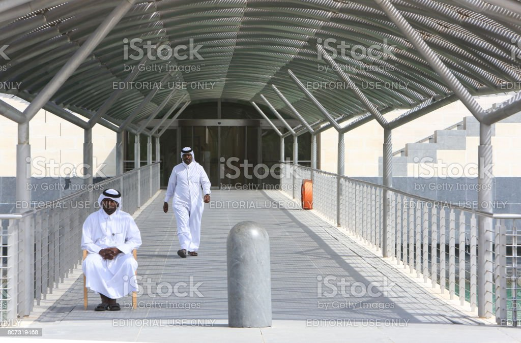 Guards at the entrance of The Museum of Islamic Art in Doha, Qatar stock photo