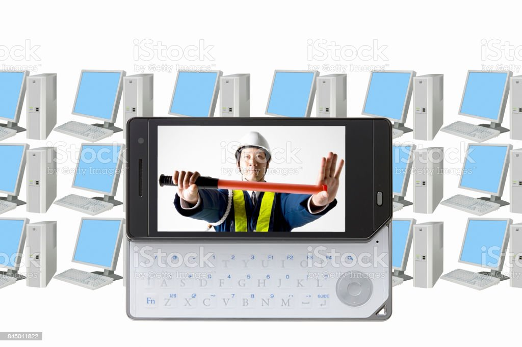 Guards on the mobile screen and the PC stock photo