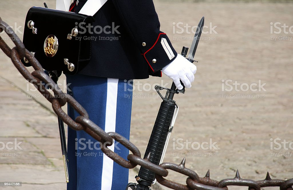 Guardsman behind old chain royalty-free stock photo