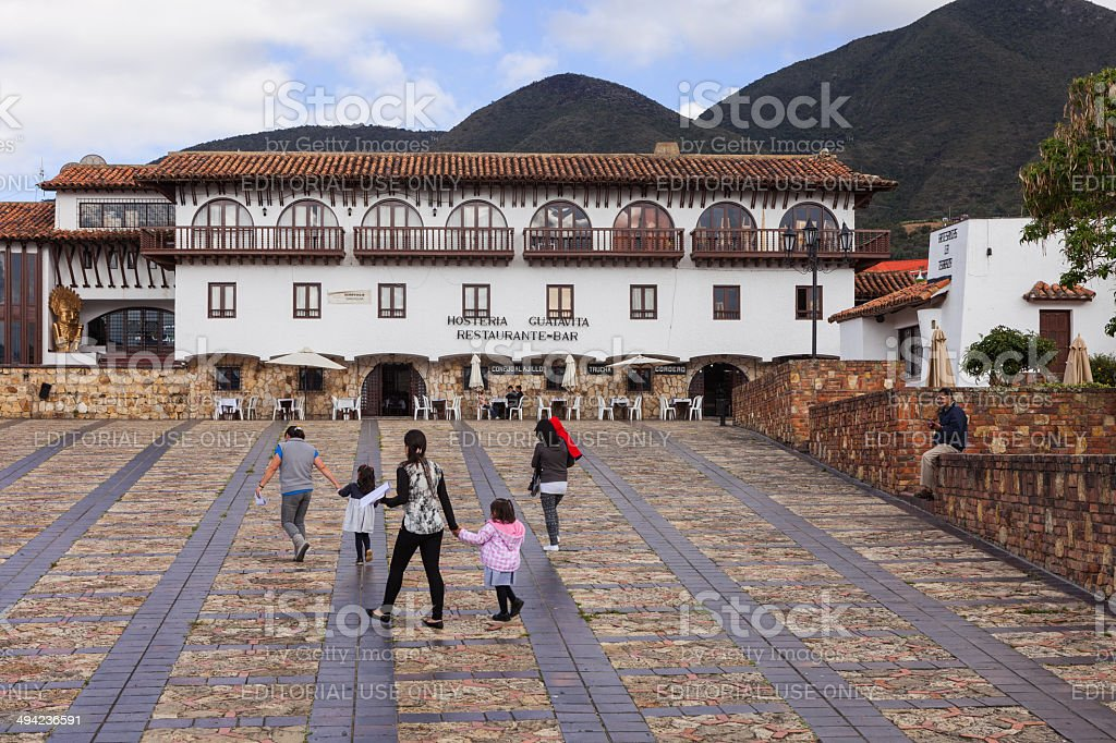 Guatavita, Colombia: People and Restaurant on plaza; colonial style architecture royalty-free stock photo