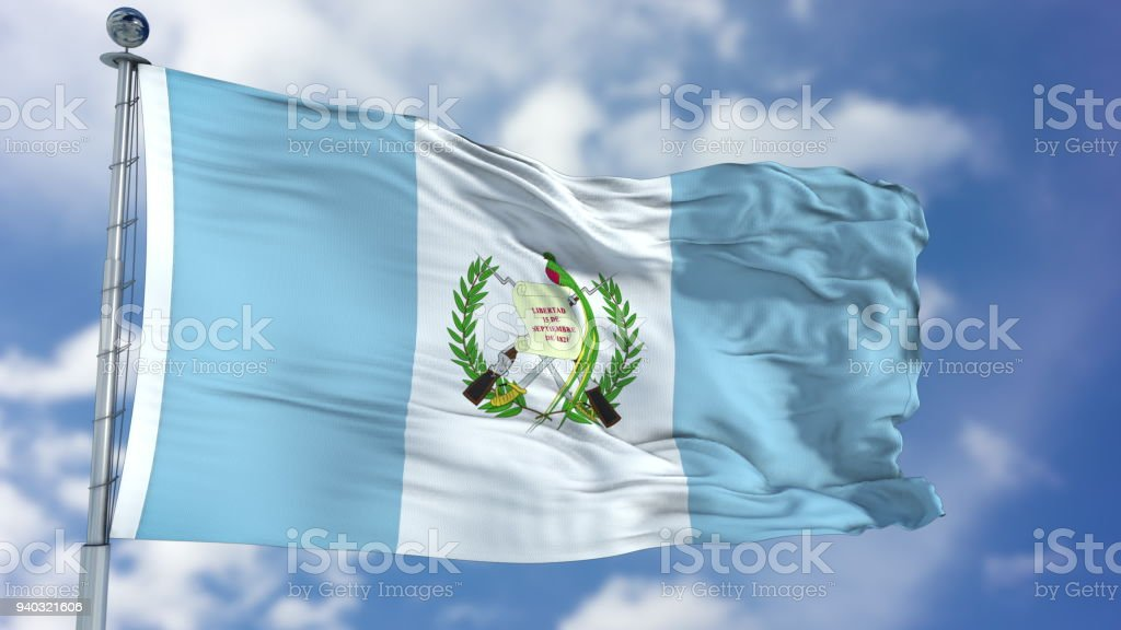 Bandera de Guatemala en un cielo azul - foto de stock