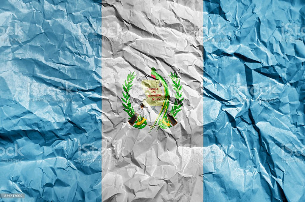 Guatemala flag painted on crumpled paper background - foto de stock
