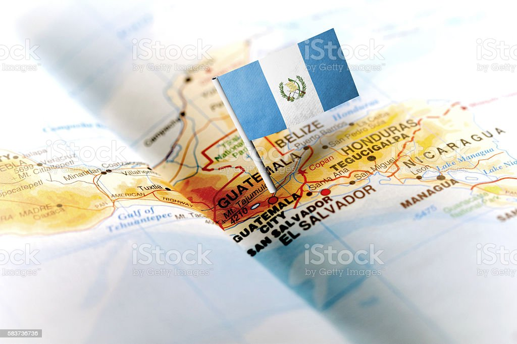 Guatemala pinned on the map with flag - foto de stock