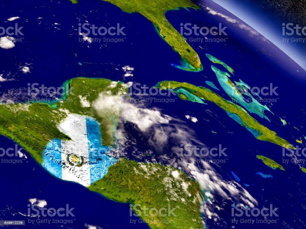 Guatemala con bandera incrustado en la tierra - foto de stock
