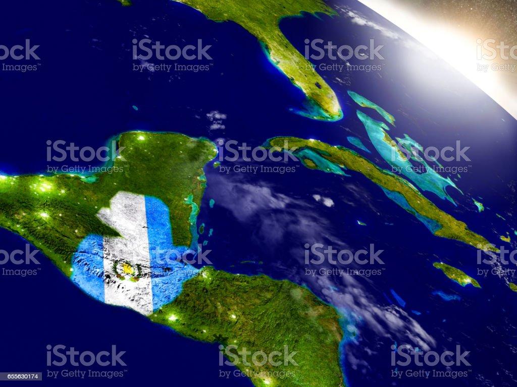 Guatemala con bandera en sol naciente - foto de stock