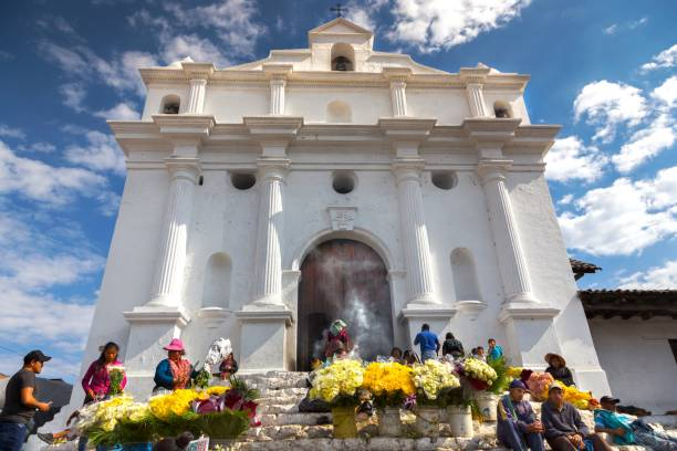 Guatemalan People Selling Flowers in Front of Iglesia De Santo Tomas on ChiChicastenango Market Day stock photo
