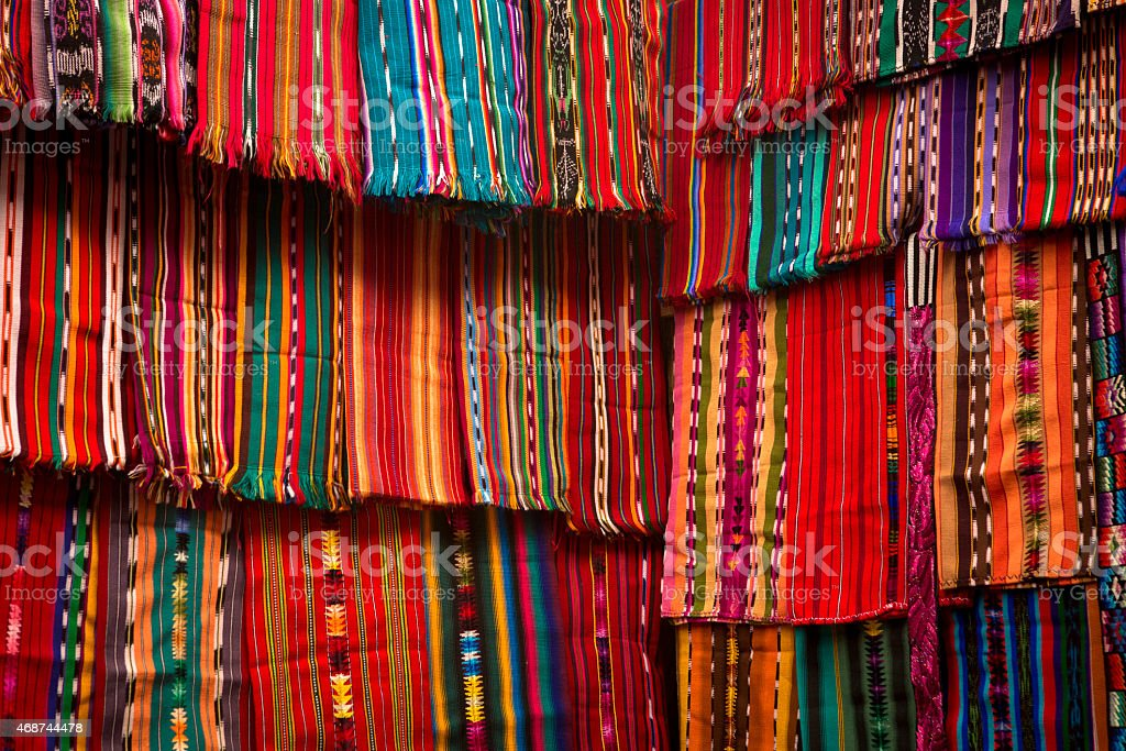 Guatemalan textile market with brightly colored cloth stock photo