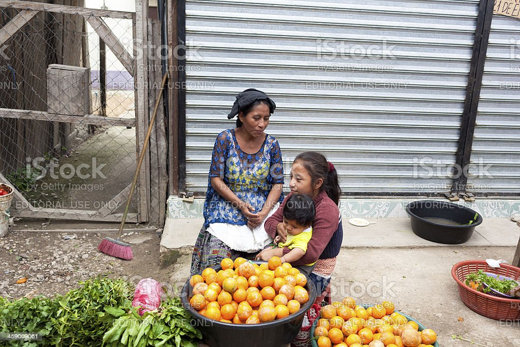 Guatemalan woman with her children stock photo