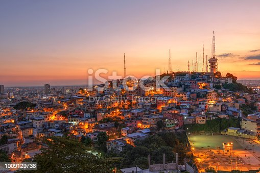 Glorios sunset over Guayaquil, Ecuador with focus on Cerro del Carmel (Carmel Hill) as seen from Cerro de Santa Ana (St. Ana Hill)
