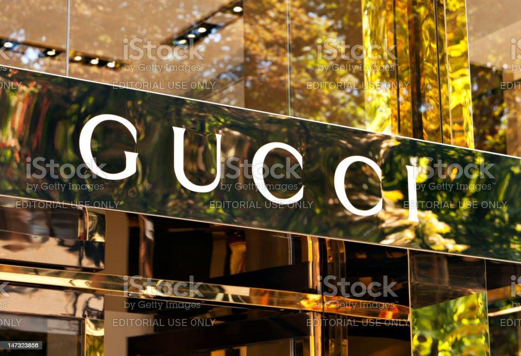 Gucci logo at store entrance stock photo