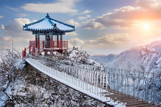 A guemosan snowy bridge at dawn stock photo