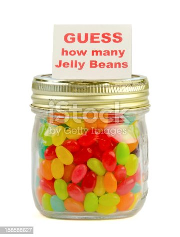 A pint mason jar of multicolored jelly beans with a printed card reading