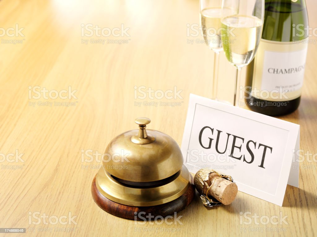 Guest at the Concierge Bell with Champagne royalty-free stock photo