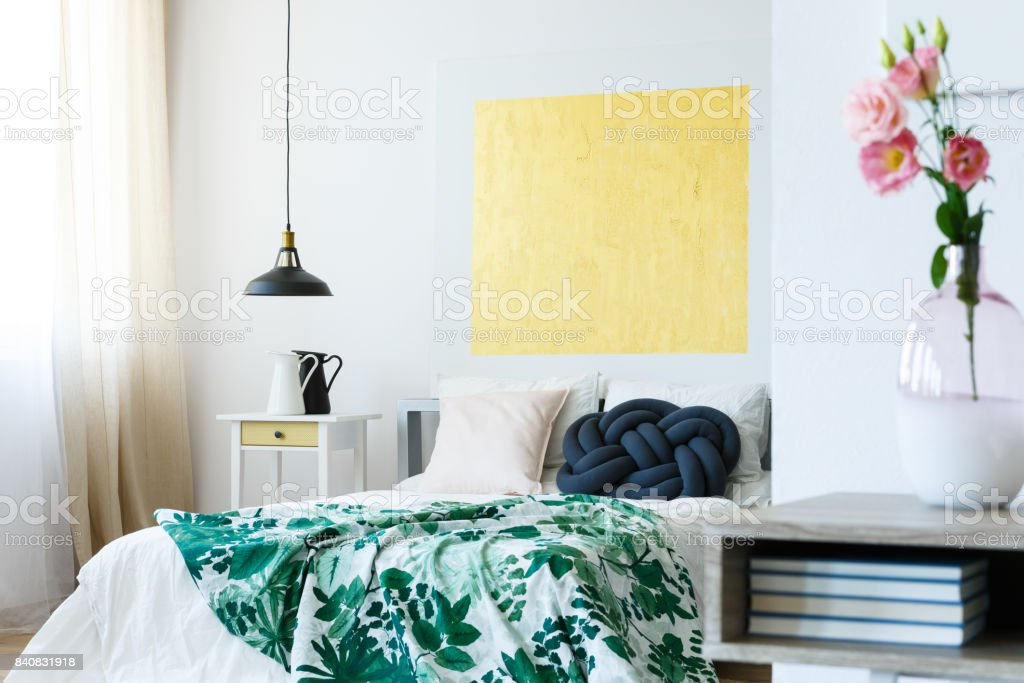 Guest bedroom with yellow artwork stock photo