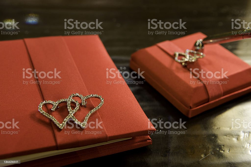 Guest Book Close-Up Detail in Red on Table royalty-free stock photo