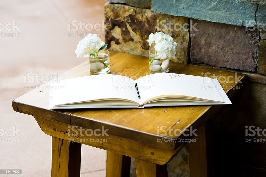 Guest Book on Wood Table to Sign at Wedding royalty-free stock photo