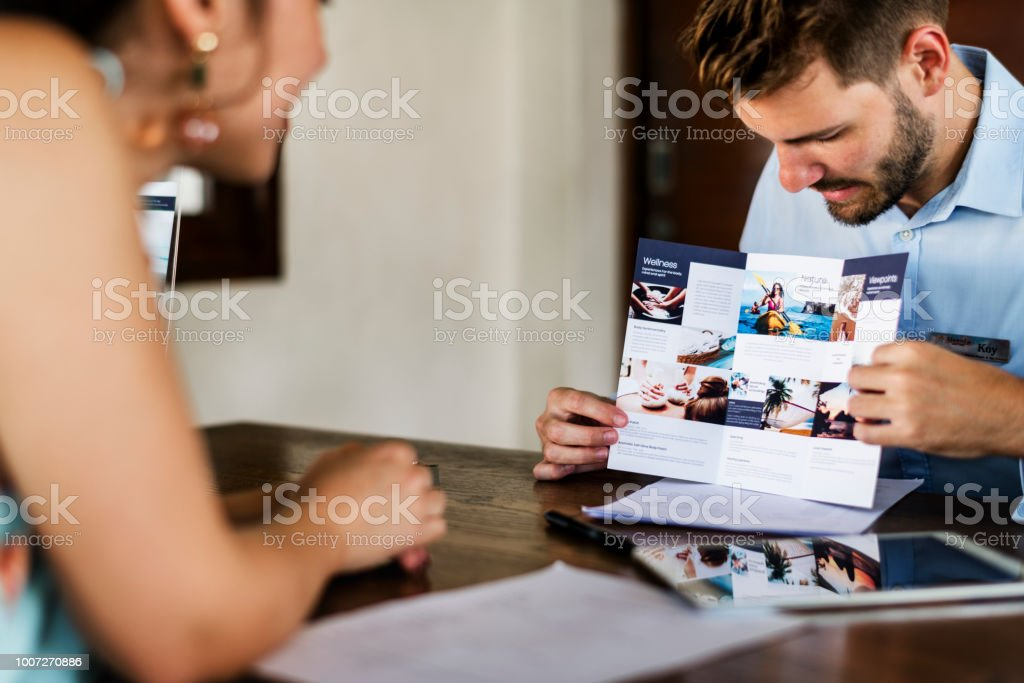 Guest booking a tour at a hotel stock photo