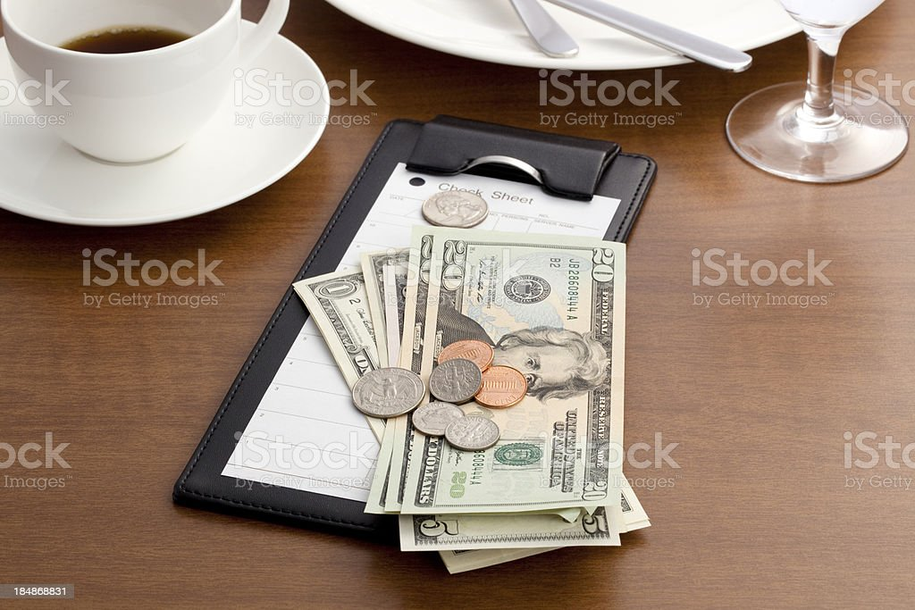 Guest check with Cash and Coin stock photo