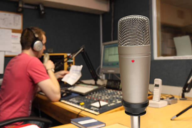 Guest view of Microphone in radio station Guest view of Microphone in radio station - the radio presenter is broadcasting live in the background radio dj stock pictures, royalty-free photos & images