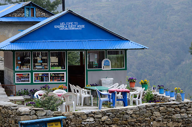 Guesthouse-cafe on way to Everest base camp,Nepal Pheriche, Nepal - April 25, 2013 : Guesthouse-cafe on the way to Everest base camp,Khumbu region in Pheriche, Nepal. Pheriche village is a beautiful natural village. tea room stock pictures, royalty-free photos & images