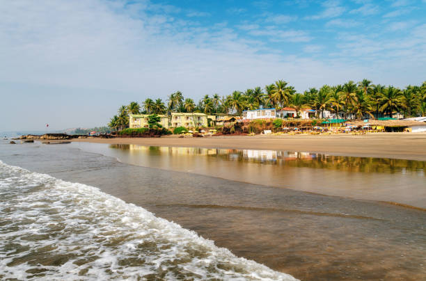 Guesthouses on beach of Arabian Sea in Ashvem, Goa stock photo