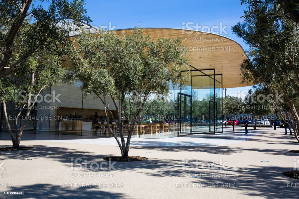 Apple Visitor Center, 1 Apple Park Way, San Jose, California, United States (USA) - January 30, 2017: Guests arrive at the Visitor Centre, a glass and wood building designed by Norman Foster, housing a cafeteria and a shop stock photo