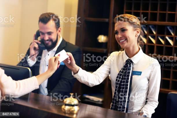 Guests getting key card in hotel picture id640147624?b=1&k=6&m=640147624&s=612x612&h=z0g26xxzzinkljku0ujstinzgq2yg pn7f6nojub4hy=