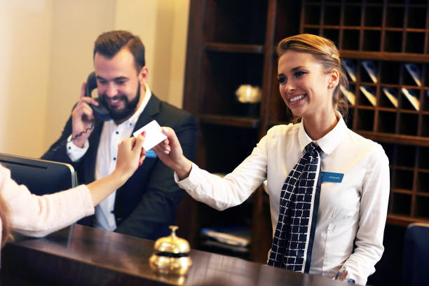 Guests getting key card in hotel stock photo