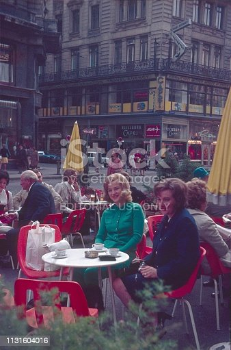 Vienna, Austria, 1972. Guests on a terrace of a street cafe in Vienna. Also: pedestrians, shops and buildings.
