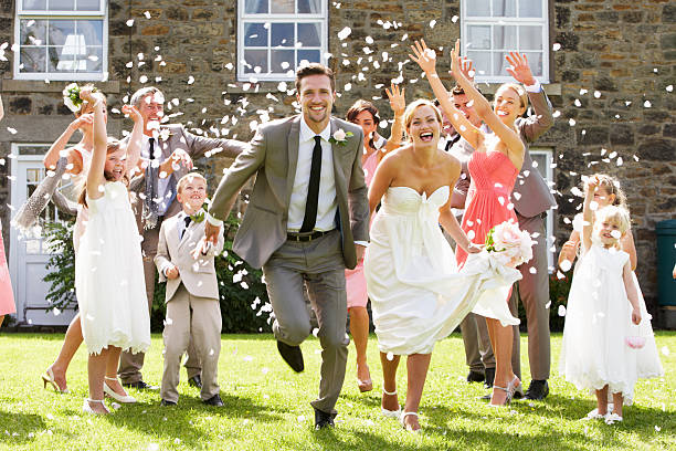 Guests Throwing Confetti Over Bride And Groom stok fotoğrafı