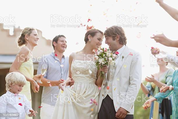 Guests throwing rose petals on bride and groom picture id102283867?b=1&k=6&m=102283867&s=612x612&h=fmnij2myiri bajzcbpnuzbs9dx7lbhbfosefnpnwm4=