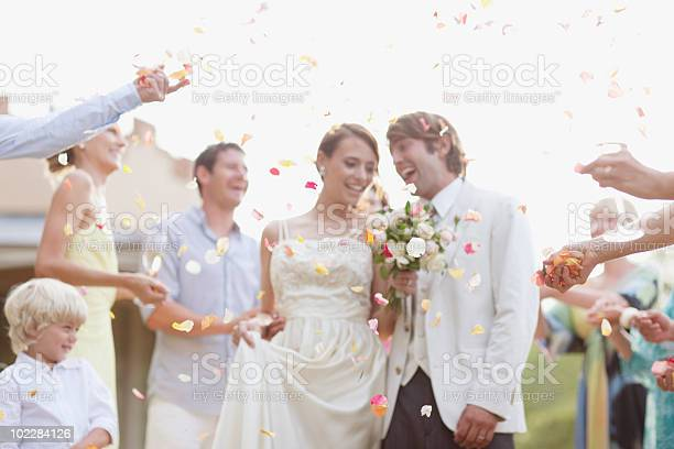Guests throwing rose petals on bride and groom picture id102284126?b=1&k=6&m=102284126&s=612x612&h=k8nbr78sz8vqqvsll1wmjkypvamgvkef iu50ak4re4=