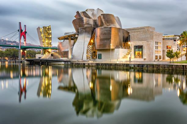 Guggenheim Bilbao museum reflection in the morning stock photo