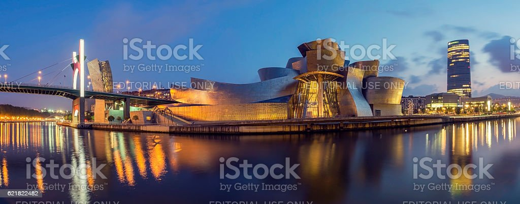 Guggenheim Museum Bilbao and Iberdrola Tower at dusk stock photo