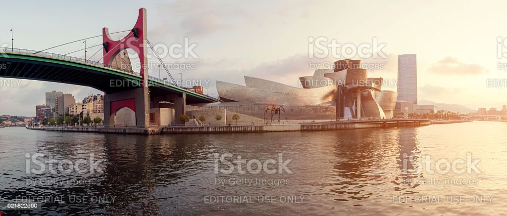 Guggenheim Museum Bilbao and Iberdrola Tower at sunset stock photo
