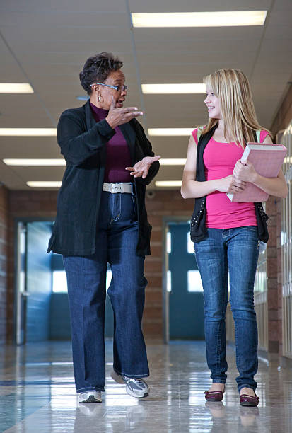 guidance counselor walking with a student - school counselor stock pictures, royalty-free photos & images