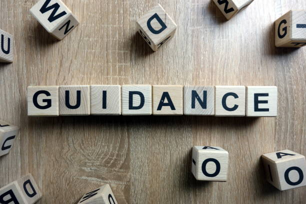 Guidance word from wooden blocks stock photo