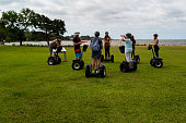 Corolla Park, North Carolina, USA -- June 10, 2020. A photo of a guide  addressing a tour group on Segways in Corolla Park, NC.