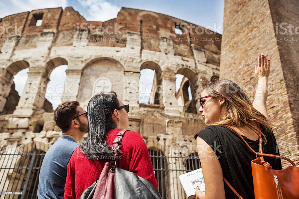 Guide explaining to tourists the Coliseum of Rome stock photo