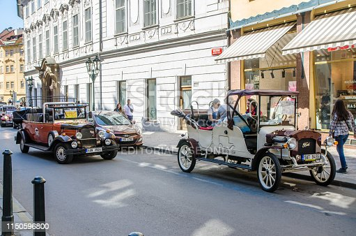 Guided tour cars imitating antique cars in Prague during day of springtime