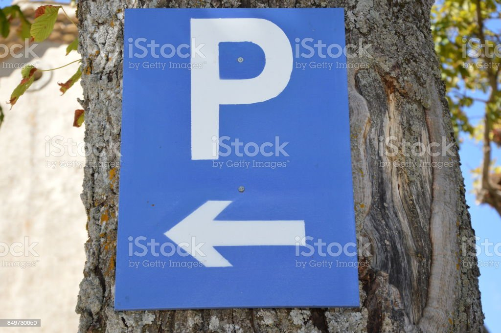 Guidepost on a tree stock photo