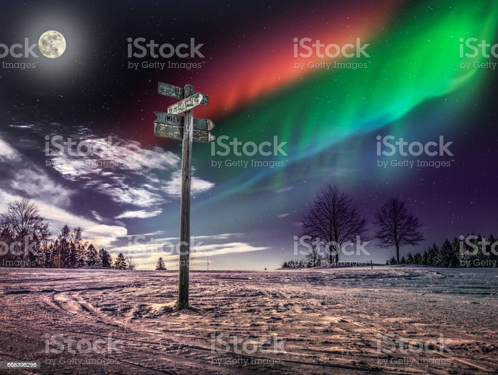 Guidepost with Moon and Nordic Light stock photo