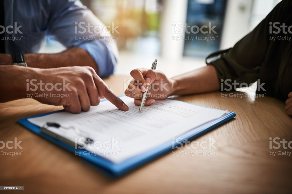 Guiding her through the consultation stock photo