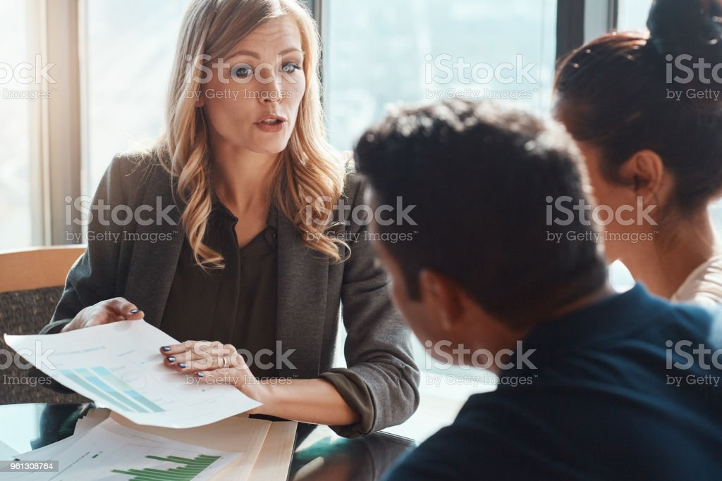 Guiding them to make good decisions for their financial future stock photo