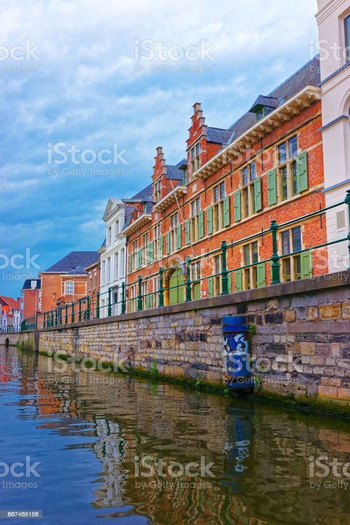 Guildhalls on Graslei and Korenlei over Lys River Ghent stock photo