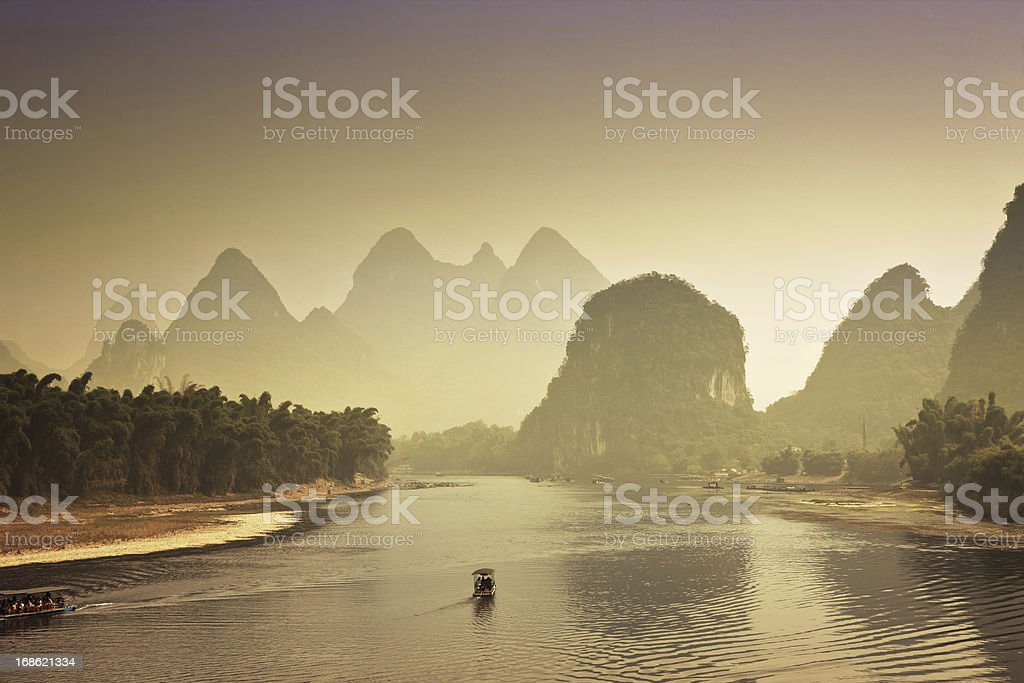 Guilin Karst mountains and river lee at sunset royalty-free stock photo